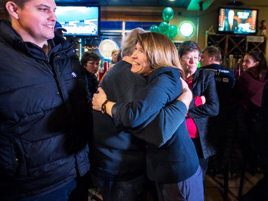 Independent candidate for mayor of Burlington Carina Driscoll hugs a supporter after conceding  to incumbent Democrat Miro Weinberger on Tuesday, March 6, 2018.