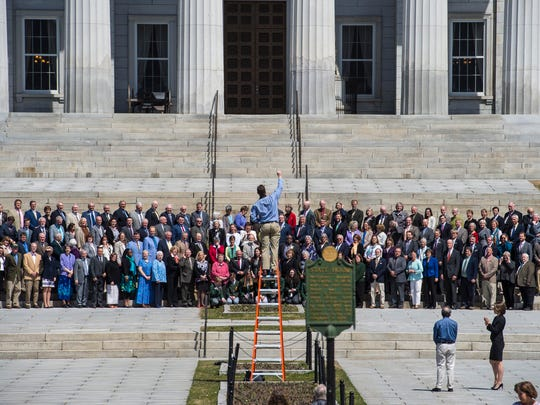 Photographer Andy Duback takes a group portrait of the members of the House of Representatives on the steps of the Statehouse in Montpelier on Tuesday, April 24, 2018.