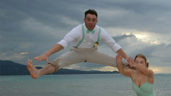 Tyler Foster jumps in the air in Jamaica.