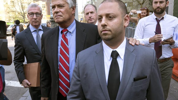 In this May 4 file photo New York Senate Majority Leader Dean Skelos, second from left, and his son Adam leave federal court in New York, after arraignment on charges. Jury selection begins Nov. 16, in the Manhattan federal court in the extortion and bribery trial of Skelos and his son, Adam.