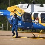 John Strickland, Rescue 7 flight nurse and paramedic, walks out of the helicopter during a demonstration at the Lamar County Multipurpose Center on Friday. Rescue 7 is working with Lifeguard, the new ambulance service for Lamar County