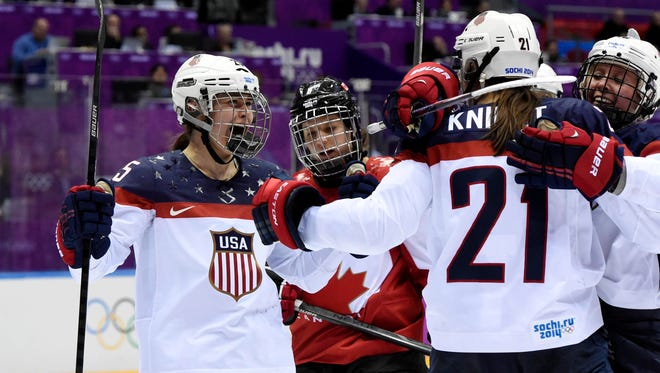American players celebrate at the 2014 Olympics in Sochi.