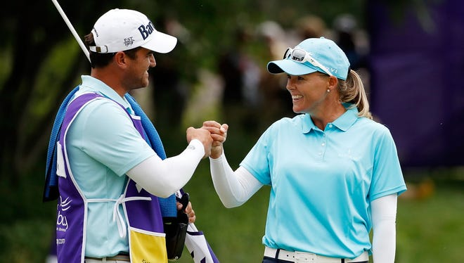 Katherine Kirk of Australia celebrates with her caddie after making a birdie on the 18th hole during the final round of the Thornberry Creek LPGA Classic on Sunday.