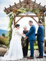 Rev. Kris Miller handfasting Stephanie Robusto and