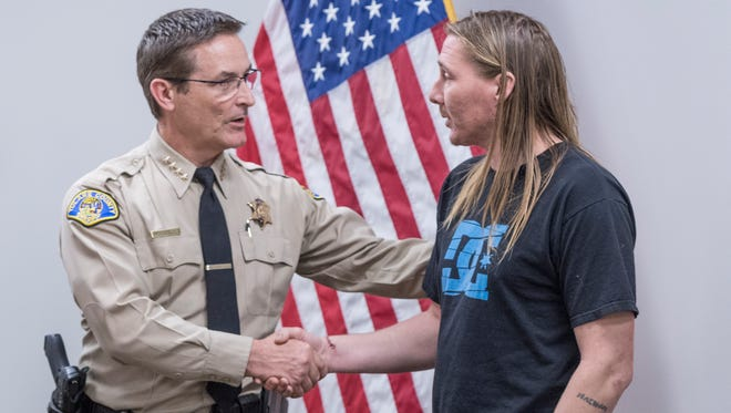 Tulare County Sheriff Mike Boudreaux thanks Nathan Wanhala for his actions Monday, March 5, 2018. Wanhala, with blood still on his shoes, talked about the scene that put himself and three other victims in the hospital with knife wounds after he and others subdued the suspect until authorities could board the bus.