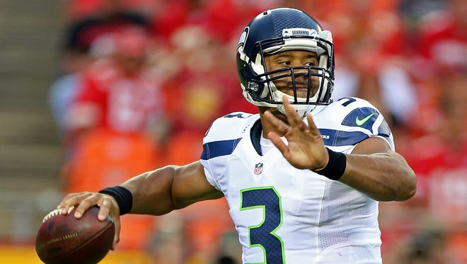 Seattle Seahawks quarterback Russell Wilson (3) throws a pass during an NFL game against the Kansas City Chiefs on Friday Aug. 21, 2015 at Arrowhead Stadium in Kansas City, Mo.