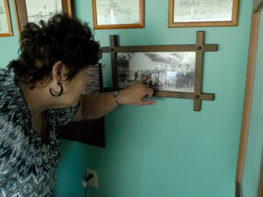 """Yvonne Widgeon points to a picture on her """"Hog Island"""""""