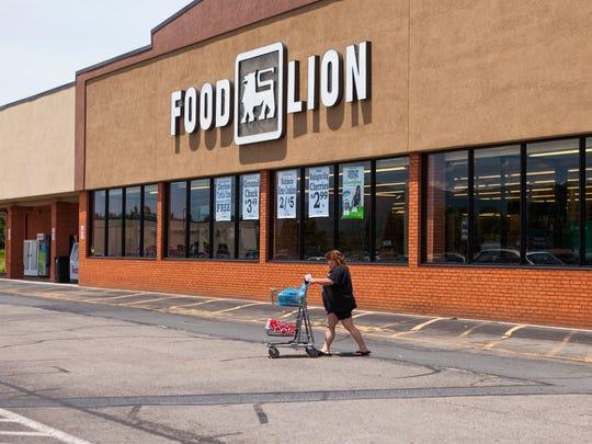 Robin Fitzgerald walks a cart through Food Lion's parking