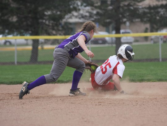Port Clinton's Emily Ashley steals second base against