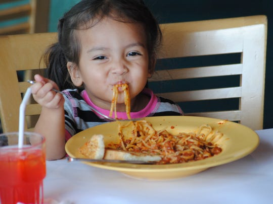 Two-year-old Rosae Sanchez has fun eating spaghetti. Mom Alex Sanchez says Rosae is normally a very neat eater.