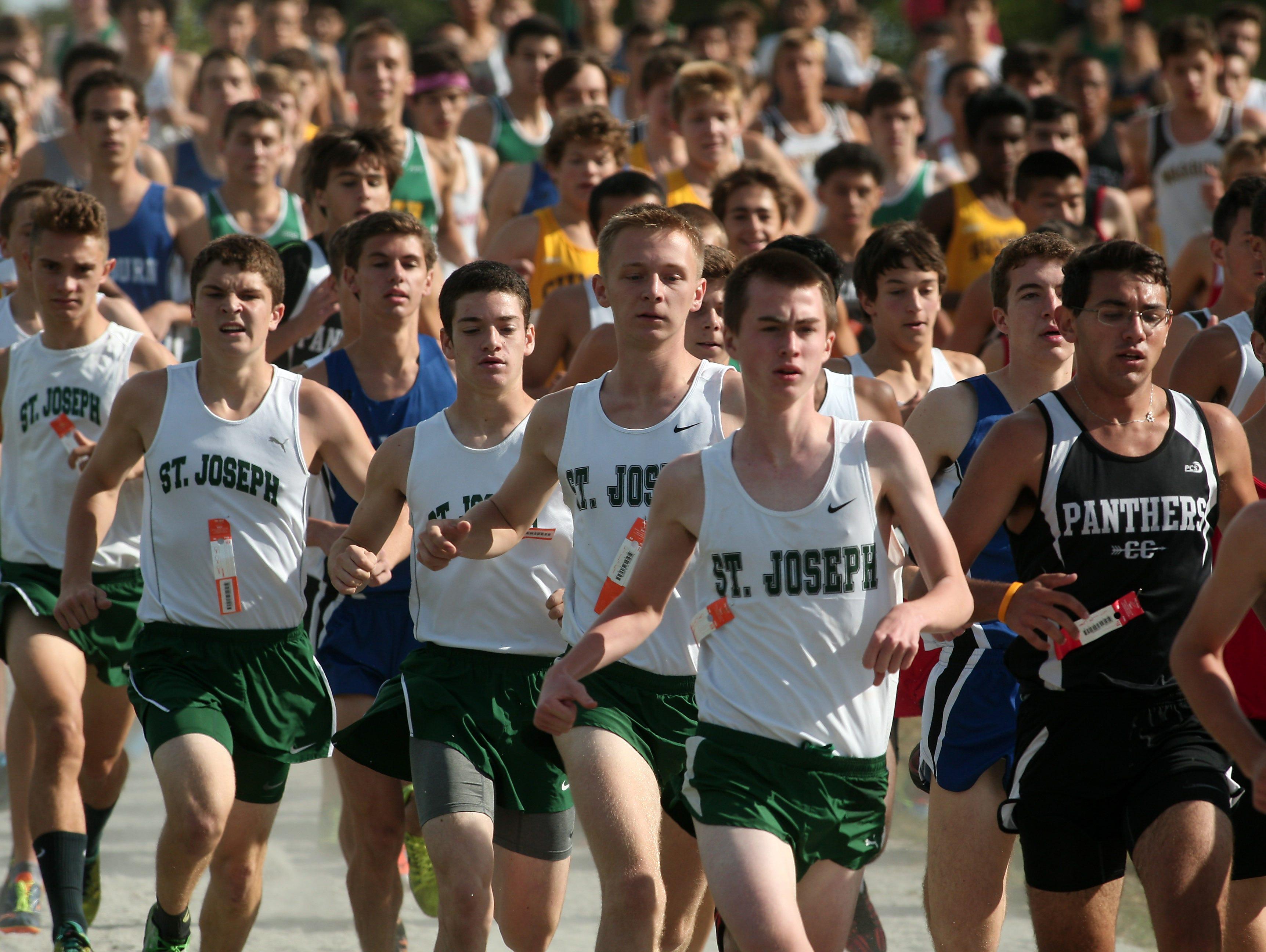 St Joseph's runners at the start of the Varsity boys A 5K run of the Stewart Memorial Invitational at Central Park of Morris County. September 26, 2015, Morris Plains, NJ.