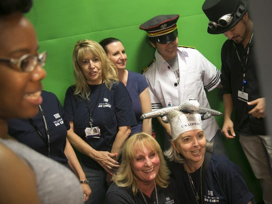 Employees gather at a photo booth for pictures during