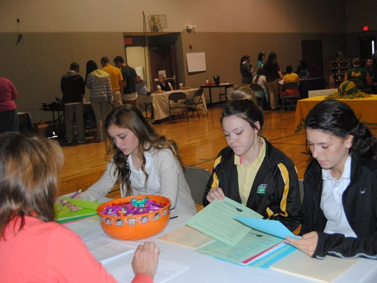 Plainview High School students meet with representatives of colleges and businesses at a college and career fair Oct. 16.