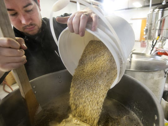 William Hampton, head brewer at Mother Bunch, stirs