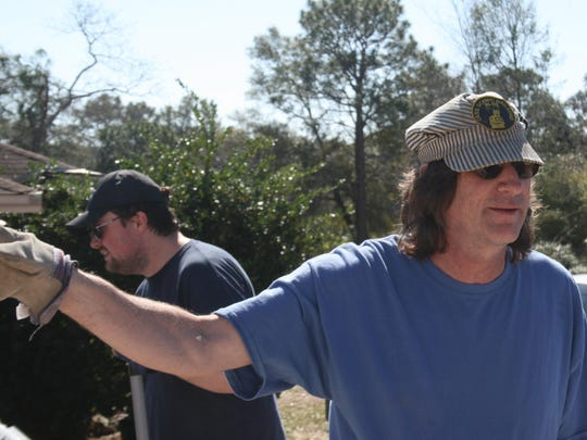 A.K. Suter Principal Russell Queen helps direct the numerous volunteers that have come out to assist him clean up tornado damage. The family's home was destroyed by the tornado.