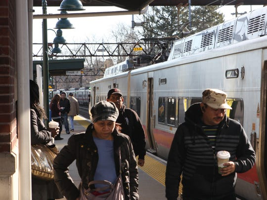 People get off of a train on the platform at the Harrison Metro-North station on Tuesday, March 22, 2016.