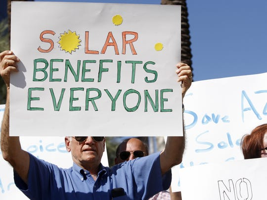 As APS sought to raise rates on solar customers, many protested before state regulators finally made a decision at the end of the year in 2013.