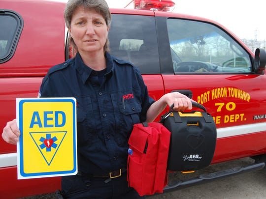 Port Huron Township Fire Capt. Ronda McLeod with an automatic external defibrillator purchased for the township's Little League.