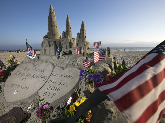 A sandcastle honoring Navy SEAL Charlie Keating at the beach in front of the Hotel del Coronado on Coronado Island, Calif., on Thursday, May 12, 2016. Keating, a graduate of Arcadia High School in Phoenix, died in northern Iraq after ISIS penetrated the area on May 3, 2016. Keating's grandfather of the same name was the famous savings and loan financier. Keating's funeral is on May 13 on Coronado Island and San Diego.