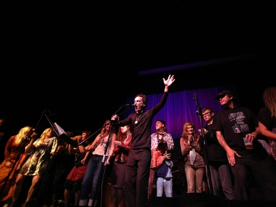 James Hall leads a group of singers during one of the Construction Zone concerts for freshly written songs at Third Avenue Playhouse in Sturgeon Bay, a traditional part of Steel Bridge Songfest.