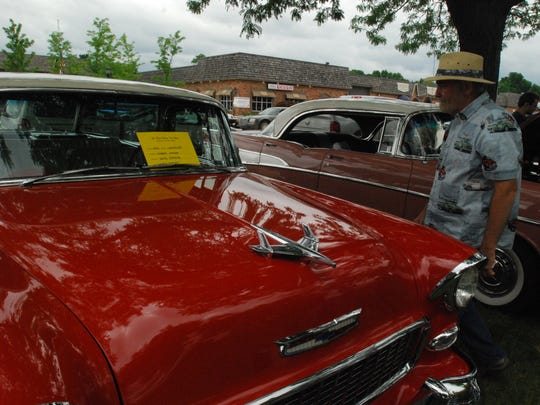 Dave Strong, of North Street, looks at his 1955 Chevrolet