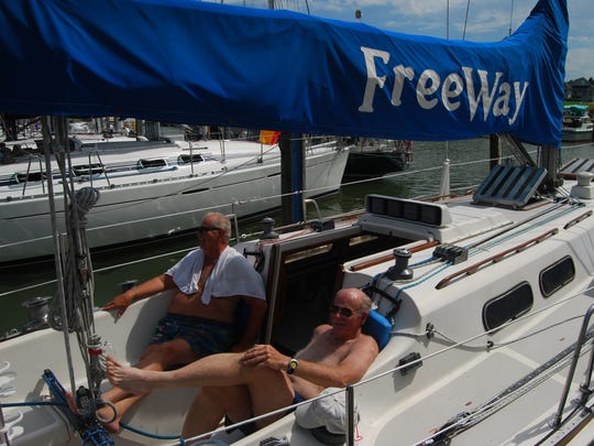 Rich and Doug Carlson relax Wednesday afternoon aboard