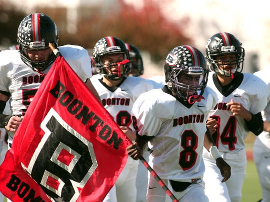Boonton football players head onto the field before a game last fall.