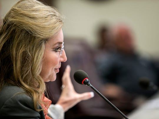 Shelby County Commissioner Heidi Shafer expresses her concerns as the public works committee discusses expanding ambulance service through the Shelby County Fire Department instead of the third-party contract.