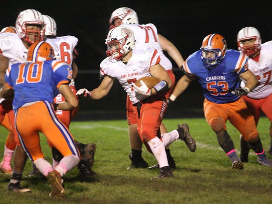 Port Clinton's Emerson Lowe carries the football Friday.