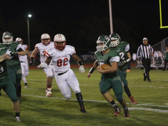 Port Clinton senior Russell DeMarco (No. 82) attacks