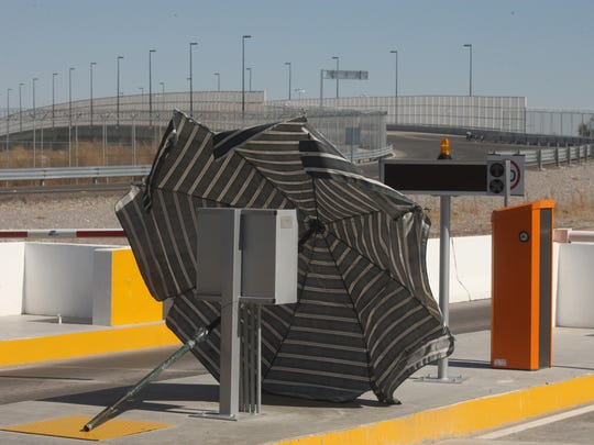 An umbrella is placed over an electrical box at the Mexican side of the Tornillo-Guadalupe international bridge to help prevent overheating.