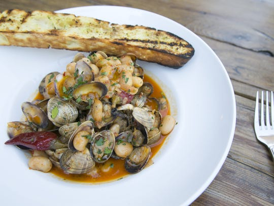 Clams with roasted garlic, white wine, 'nduja, butter