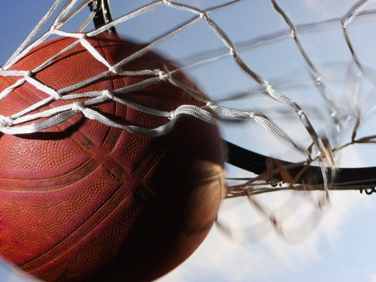 Basketball scoring points through the net