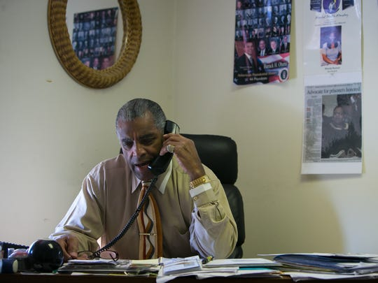 Herman Holloway Jr., chairman of the board for the Wilmington Housing Authority, works in his office in New Castle.