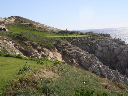 Hole 13 at Quivira is a par-three that requires a shot over a gorge along the coastline.