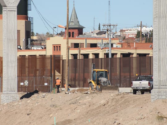 Border Patrol agents patrol a section of the border fence earlier this year along the Paisano Street construction site near Downtown El Paso.