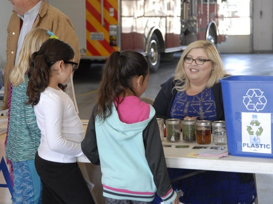 Yerington students learn about different types of liquid and the importance of recycling at a volunteer fair on April 19 at the city's Main Street fair station.