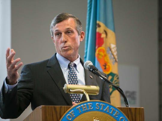 Gov. John Carney speaks before he signs House Bill