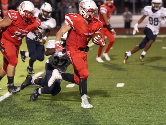 Port Clinton's Ian Willoughby carries the football