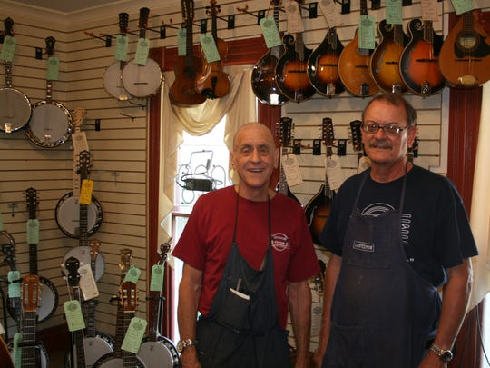 From left: Brothers Richard and David Stutzman. of Stutzman Guitar Center in Greece.