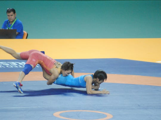 In this file photo, Mia-Lahnee Aquino, right, of Team Guam, is taken to the mat by Kizy Marsbek, of Kazakstan at the 5th Asian Indoor & Martial Arts Games, in Turkmenistan. Marsbek won the match by technical superiority, ending Aquino's shot at the medal round.
