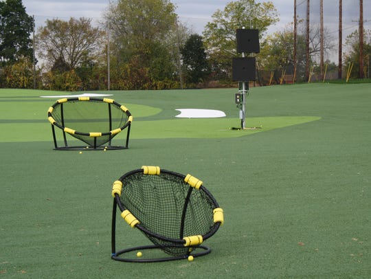 Two of the five radars on the TrackMan Range at Carl's