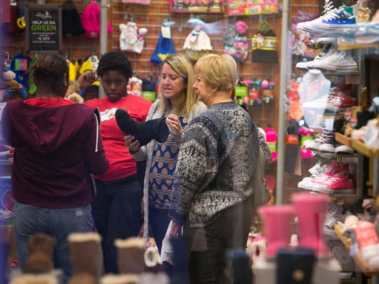 Kathy Bendle of Chesapeake Beach, MD has been doing Black Friday shopping at Christiana Mall in Newark for 20 years with her family.