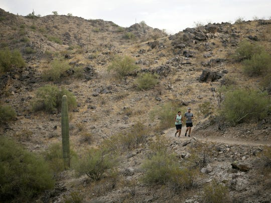 Trail runners along the Rainbow Valley Trail in the Estrella Mountain Regional Park in Goodyear on November 15, 2017.
