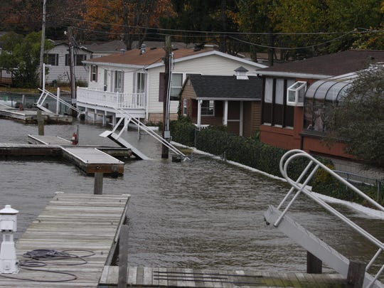 Docks rise in the water road on Ba Mar Drive in Stony