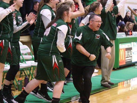 Coach Tom Kontak celebrates Oak Harbor's 47-42 victory