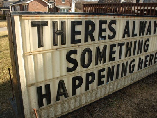 """A sign outside The Blind Tiger Pub in Johnson City reads """"there's always something happening here."""""""