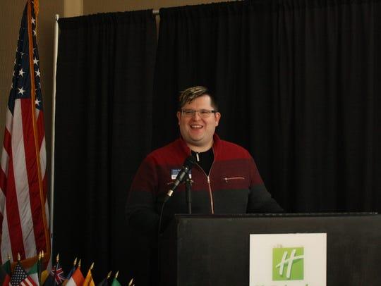 Binghamton Rotary Club president Jesse Katen speaks