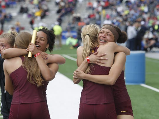 Members of the Ankeny girls 4x100 relay team celebrate their second-place finish in the 2017 class 4A state meet on at Drake Stadium. Mikala Sidney, right, hugs Kelsey Fischer while Jasmine Rumley, left, hugs Peyton Daugherty. The Hawkettes posted a time of 48.62 seconds that broke a 20-year-old school record.
