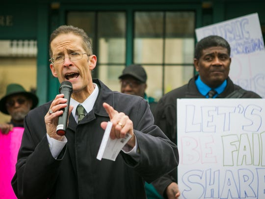 Scott Spencer (left), a transportation consultant, joins The Coalition to Keep Bus Service on Rodney Square at an April 2 rally urging DART to restore the Rodney Square bus hub that was dismantled by DART in December.